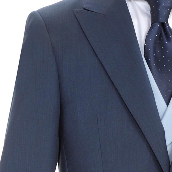 detalle chaqueta chaqué azul