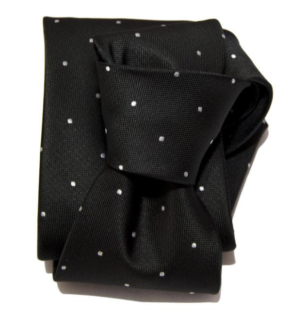 Corbata negra pequeños lunares blancos.