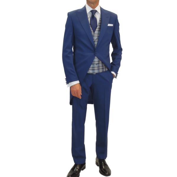 Semichaqué azul con pantalón al tono y chaleco gales celeste