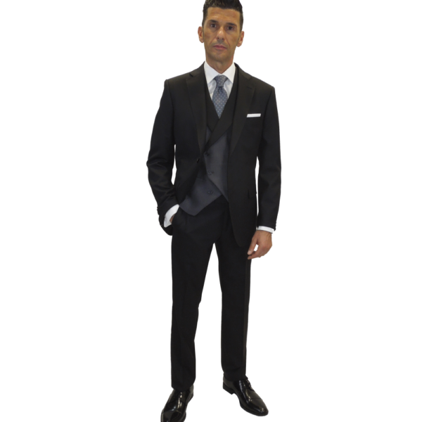 Traje de espiga, blazer y pantalón negro, chaleco gris marengo